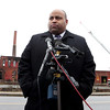 Lawrence Mayor Daniel Rivera briefs the media as firefighters continue work behind him at the Merrimac Paper Company in Lawrence.Photo by Mary Schwalm