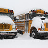 MARY SCHWALM/Staff photo  School buses remain covered in snow in Andover.  Buses were a low priority in snow removal given the schools were closed.  2/5/14