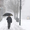 Ken Yuszkus/Staff photo. Derry:  Peter Mannarini walks home from work under an umbrella on West Broadway in Derry during the snowstorm Wednesday morning.