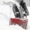 Ken Yuszkus/Staff photo. Salem:  John Armstrong removes the snow from his driveway with a snowblower during the snowstorm Wednesday morning in Salem.