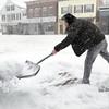 Ken Yuszkus/Staff photo. Derry:  Vinny Ta shovels the sidewalk on West Broadway in Derry on Wednesday morning.