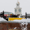 MARY SCHWALM/Staff photo  A truck clears snow through an opening in a fence from the second story parking area at Woodworth Motors in Andover.  2/5/14
