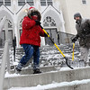 Ken Yuszkus/Staff photo. Derry:  Amber Mason, left, Richard Kallelis, and not pictured, Nicholas Kallelis-Mason, shovel the steps of Saint Thomas Aquinas in Derry early Wednesday morning.