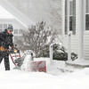 Ken Yuszkus/Staff photo. Windham:  Windham maintainence worker Bruce Montgomery uses a snowblower during the snowstorm Wednesday morning to clear the walkways near the Bartley House.