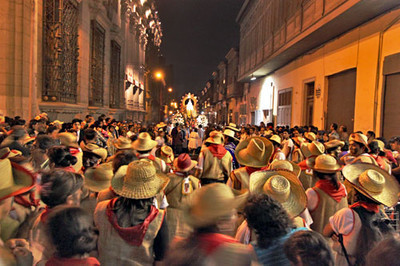 Hours later, worshipers are still carrying Virgen de la Puerta through the streets of Lima