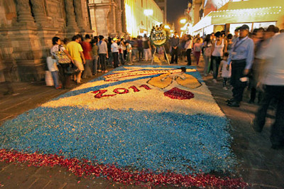 Alfombra, a carpet of flower petals, is created on Jiron de la Union pedestrian mall