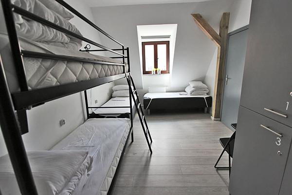 Four-bed dorm at Soda Hostel in Poznan, Poland