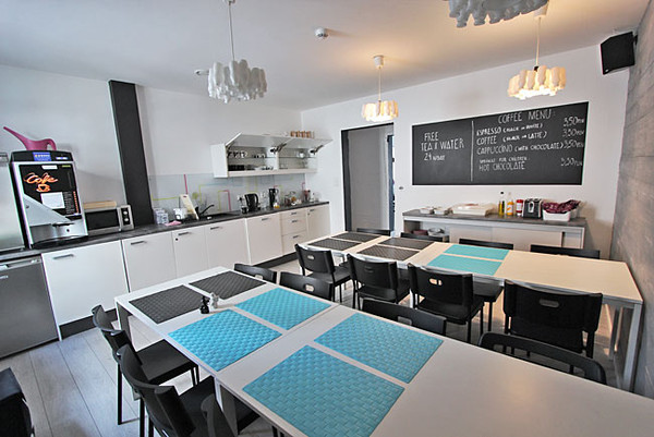 Common area kitchen at Soda Hostel