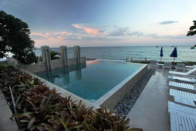 Beachfront infinity pool at Nern Chalet Hotel in Hua Hin, Thailand