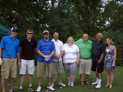 Freedom Alliance Scholarship recipients Hollis Troxel, Krista and Jamison Couch, and Chrissy Smith pose with golfers at the Miami Valley Golf Classic in July 2011.