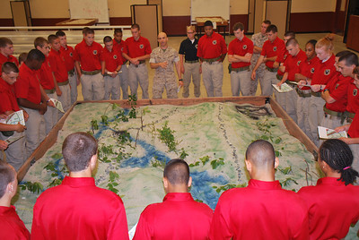 2011 Cadets conduct a Tactical Decision Game utilizing sand tables while touring the Marine Corps' The Basic School, at Quantico, VA.