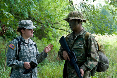 Instructor Alysha Barry provides tips and ways to improve in an After Action Report for Squad Leader Winston Yu, shortly after leading his squad through a patrol lane during a two day Field Training Exercise.