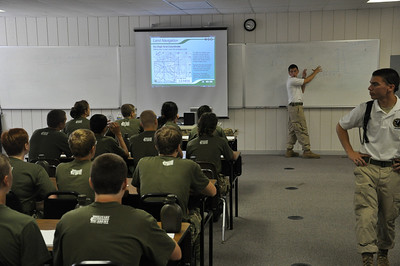 Leadership introduced in the classroom before hitting the field. 2010 Cadets learn Land Navigation techniques before orienteering in squads through the close terrain of the Land Navigation South Course at Fort Pickett.