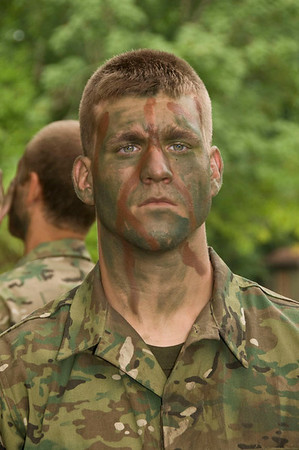 Two-time Cadet Mike Mosczczynski shortly after applying face paint during a Field Training Exercise.