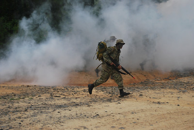 Popping smoke at Fort Pickett. 2009 Cadet Clark Cali leads his platoon during a Field Training Exercise.