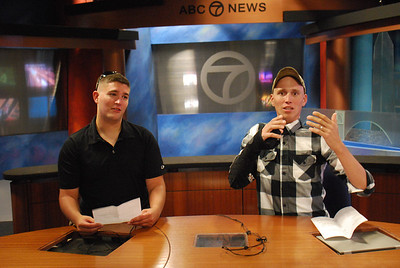 Injured servicemen from Walter Reed goof around on the set of ABC 7 News.