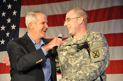 LtCol Oliver North, USMC (Ret.) shares a light moment with Army Private First Class Bryan at the Sean Hannity Salute to the Troops Holiday Concert in Washington, D.C.