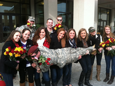 The ladies of Alpha Chi Omega from the University of Maryland help deliver Valentine's Day roses to troops recovering at Walter Reed.