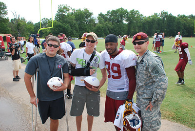 Wounded servicemen recovering at Walter Reed meet members of the Washington Redskins at Redskins Training Camp in Ashburn, Virginia.