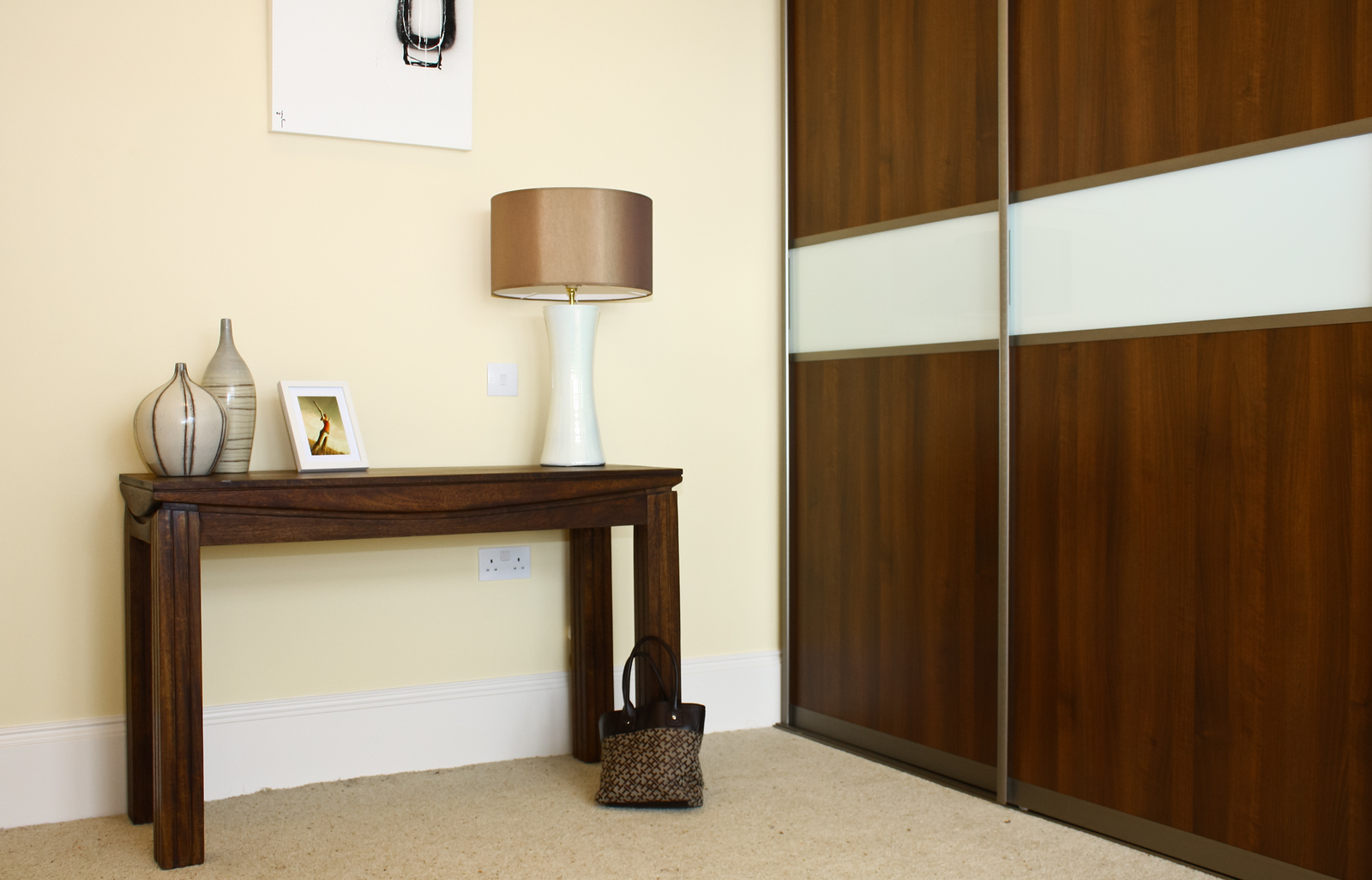 Wood-effect panels combine with white glass