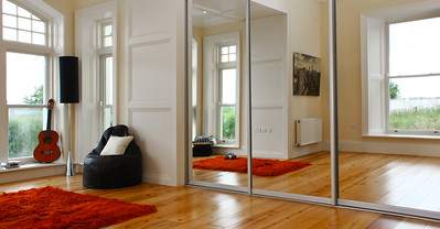 Full length mirrored doors with brushed aluminium profiles