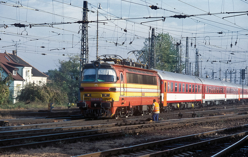 Bratislava Hlavni Stanica is a great place to sit and watch the 'Laminatki' of both ZSSK and CD - with a train of traditional livery coaches (including some alterations!) ZSSK 240-114 enters the station on 8 November 2006
