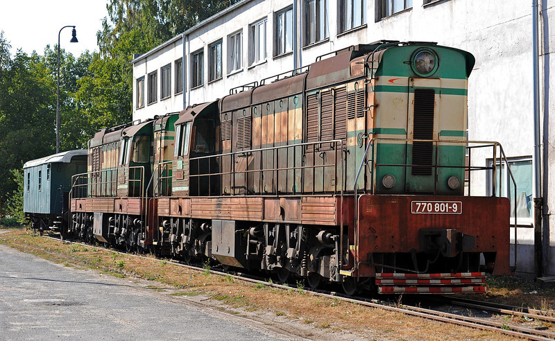 Rust or iron ore seem to be the standard livery of the heavy shunters used at the steel works - 770-801 and 770-803 are at the side of the depot buildings at Haniska pri Kosiciach on 27 September 2011