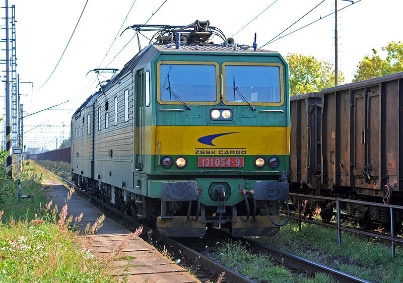 With an east-bound freight still pulling through the station ZS 131-054/053 passes Cierna nad Tisou zastava on 26 September 2011