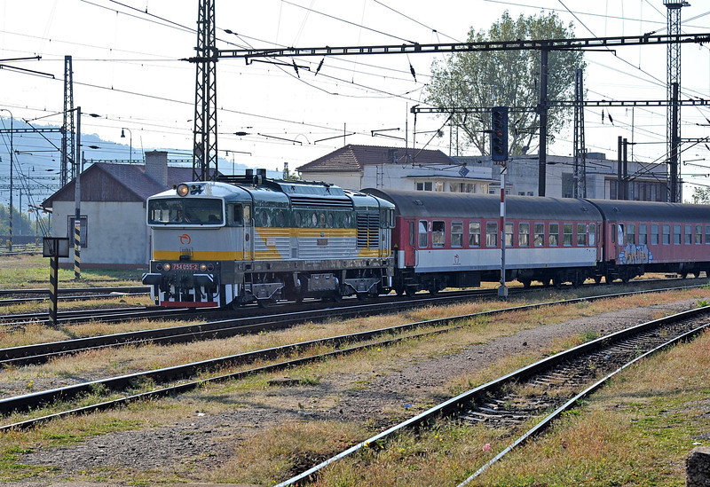 The high gloss finish of ZS 754-055 contrasts with the dead matt finish of the coaches as it arrives at Kosice with a passenger service from Zvolen on 27 September 2011