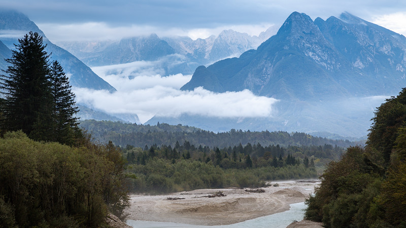 The Alpine Peaks of the Parco Naturale Regionale delle Prealpi Giulie (It) seen from the Soča River Valley in Slovenia