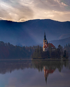 The church at Bled captures a ray of light breaking through the clouds