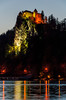 The hilltop Castle illuminated at night in Bled, Slovenia.