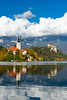 The Pilgrimage Church of the Assumption of Maria island Church reflected in Lake Bled, Slovenia, Europe.
