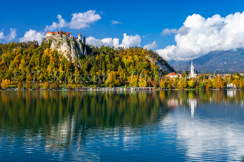 Bled Castle reflected in Lake Bled, Slovenia, Europe.