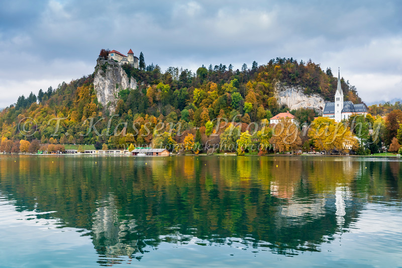 The island Church and castle reflected in Lake Bled, Slovenia, Europe.