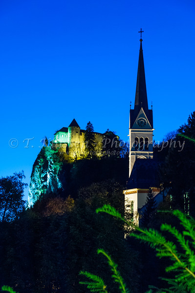 The St. Martin's Parish Church and Castle at dusk in Bled, Slovenia, Europe.