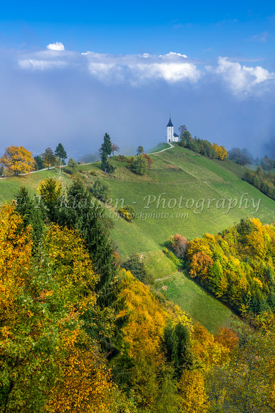 Church of St Primoz with fall foliage color above the village of Jamnik, Slovenia, Europe.