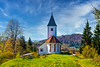 A small church with fall foliage color in Kalise, Strahovica, Kamnik, Slovenia, Europe.