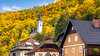 The village of Kropa, Slovenia with fall foliage color.