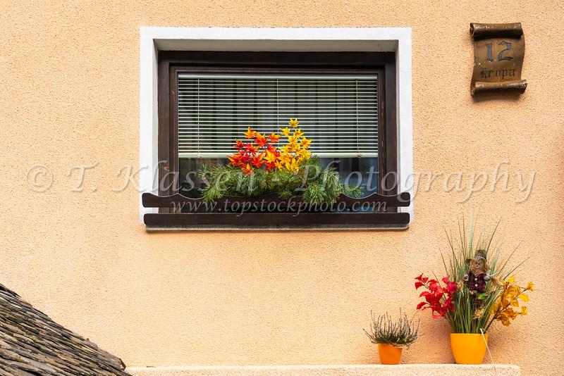 A decorative window in the village of Kropa, Slovenia, Europe.