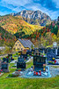 The cemetery of the Church of St. Mary of the Snows with fall foliage color in Solcava, Slovenia, Europe.