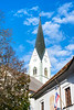 The St. Peter's Church steeple in the medieval town of Radovljica, Slovenia, Europe.