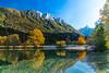 The Julian Alps reflected in Lake Jasna before sunset near Kranjska Gora, Slovenia, Europe.