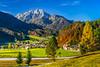The resort town of Kranjska Gora with fall foliage color in the Julian Alps, Slovenia, Europe.