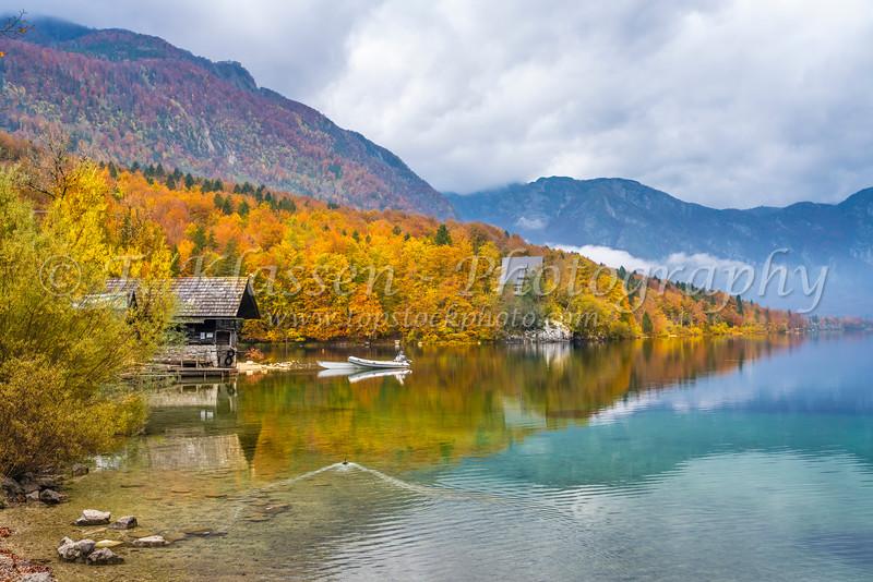 Lake Bohinj with fall foliage color, Slovenia, Europe.