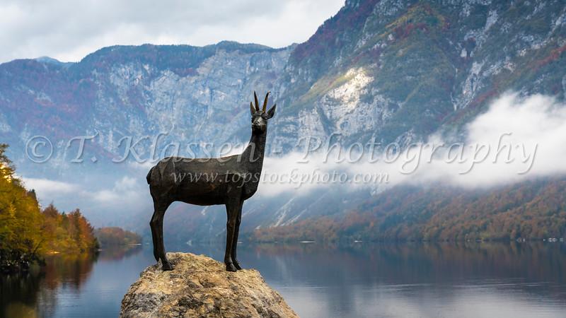 The Legendary Goldhorn bronze statue at Lake Bohinj, Slovenia, Europe.