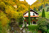 A small cottage with fall foliage color near the village of Koritnica, Slovenia, Europe.