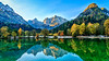 The Julian Alps reflected in Lake Jasna at sunrise near Kranjska Gora, Slovenia, Europe.