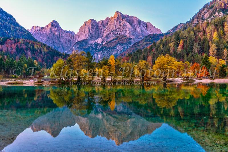 The Julian Alps reflected in Lake Jasna before sunrise near Kranjska Gora, Slovenia, Europe.