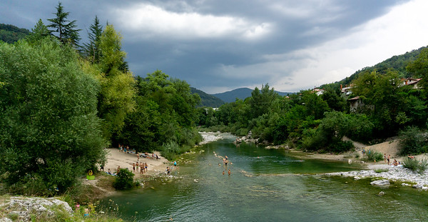 Bathers in the Isonzo river with an approaching storm